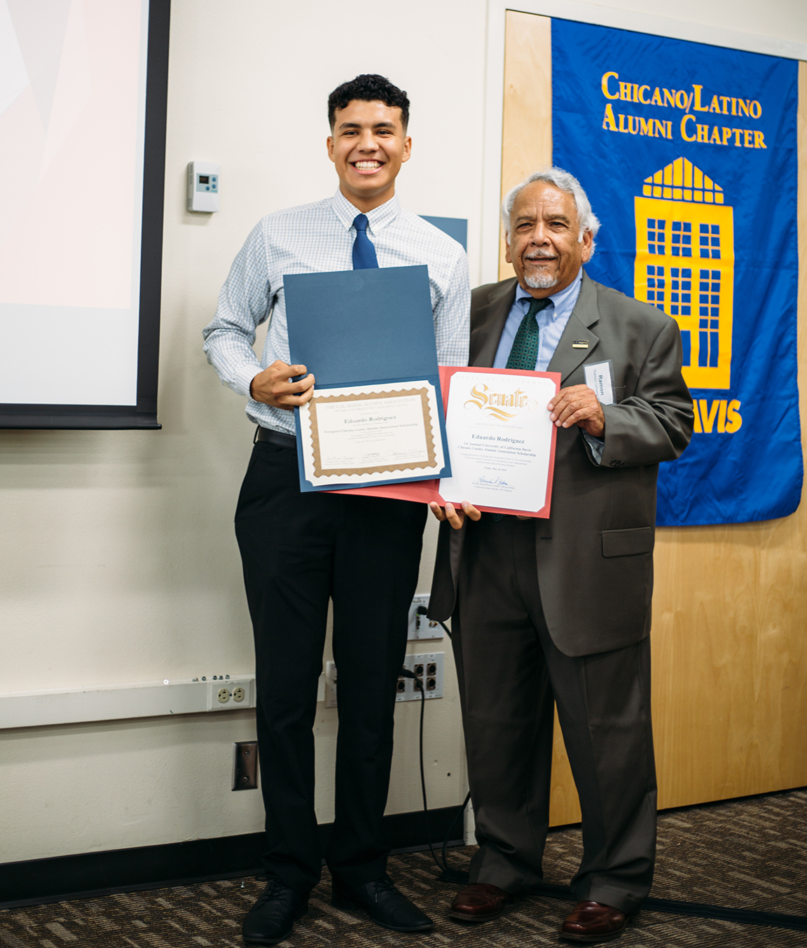 Student receiving  a scholarship from the Chicanx Latinx Alumni Association