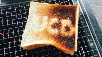 Toast on a grill with letters UCD on it