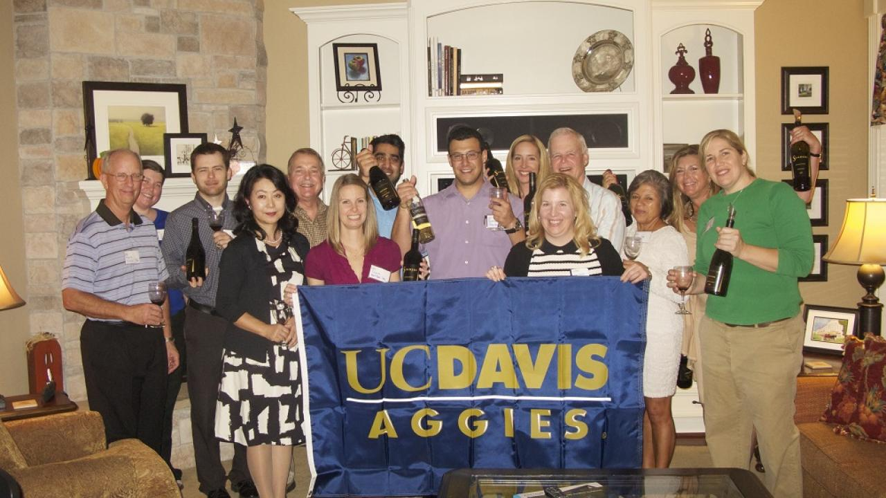 Houston Aggies holding up a UC Davis flag