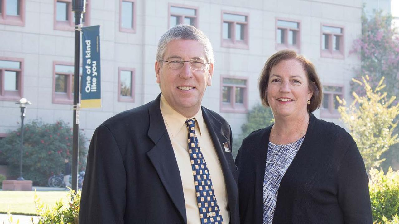 Deborah Neff stands with College of Biological Sciences Dean Mark Winey