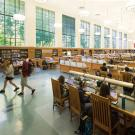 Students studying and walking around the reading room in Shield Library at UC Davis