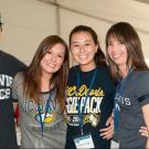 Picture of four people wearing UC Davis t-shirts.