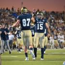 Picture of Jake Maier and Wes Preece high fiving on the football field