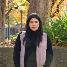 Mariel Becerra Arellano standing outdoors in the fall at UC Davis